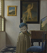 tablou johannes vermeer - a young woman standing at a virginal